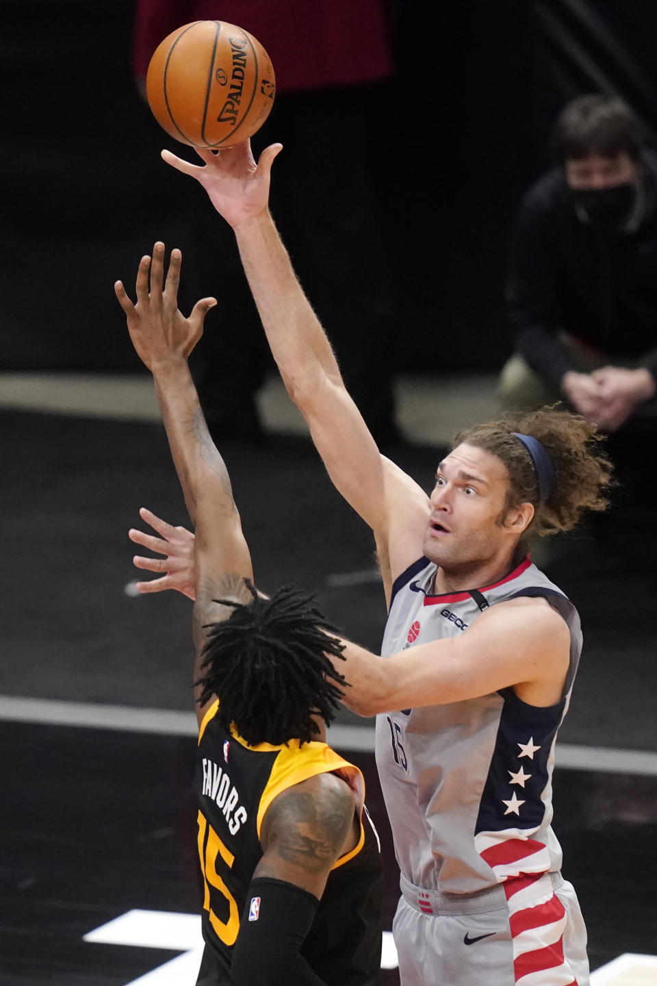 Washington Wizards center Robin Lopez, right, shoots as Utah Jazz center Derrick Favors, left, defends in the first half during an NBA basketball game Monday, April 12, 2021, in Salt Lake City. (AP Photo/Rick Bowmer)