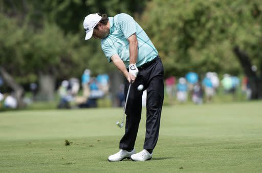 Tim Clark, of South Africa, hits on the ninth fairway during the final round of the Canadian Open golf tournament, Sunday, July 27, 2014, in Montreal. (AP Photo/The Canadian Press, Paul Chiasson)