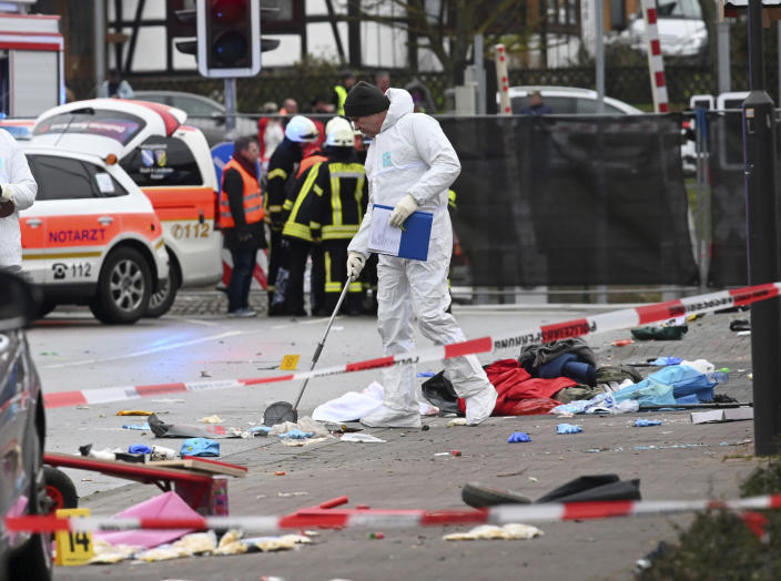 Police cordoned off the area as investigators scoured the scene for evidence. (Uwe Zucchi/dpa via AP)