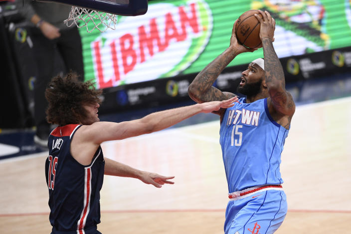 Houston Rockets center DeMarcus Cousins, right, goes to the basket against Washington Wizards center Robin Lopez, left, during the second half of an NBA basketball game, Monday, Feb. 15, 2021, in Washington. (AP Photo/Nick Wass)