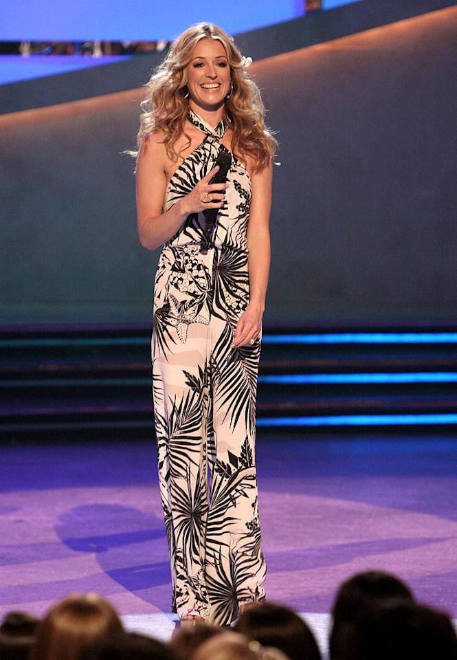 "<a href=""/cat-deeley/contributor/2212390"">Cat Deeley</a> channeled '70s style when she wore a palm tree-print jumpsuit when she had to send two of the Top 16 dancers home on Season 5 of <a href=""/so-you-think-you-can-dance/show/36160"">""So You Think You Can Dance.""</a>"