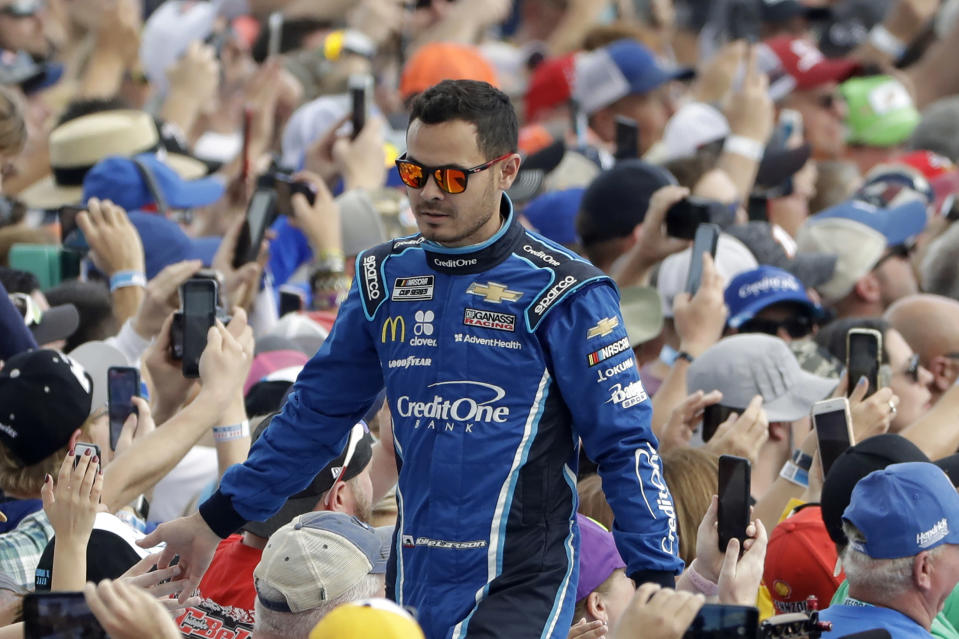 FILE - In this Sunday, Feb. 16, 2020, file photo, Kyle Larson greets fans before the NASCAR Daytona 500 auto race at Daytona International Speedway in Daytona Beach, Fla. Despite being suspended for six months for the use of a racial slur, Kyle Larson remains a popular figure in dirt track racing. (AP Photo/Chris O'Meara, File)