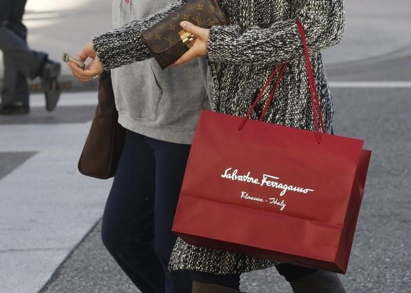 A shopper carries her purchases from the Salvatore Ferragamo boutique on Rodeo Drive in Beverly Hills