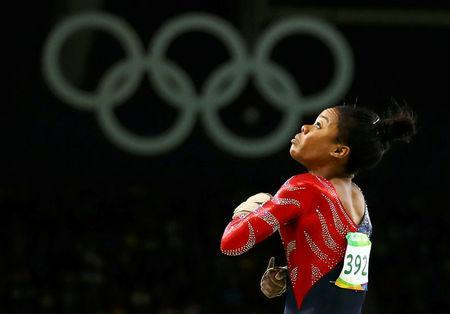 Gabrielle Douglas (USA) of USA (Gabby Douglas) competes on the vault during the women's qualifications. REUTERS/Mike Blake/File Photo