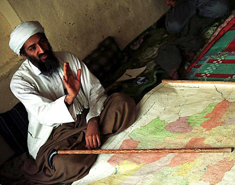FILE - This April 1998 file photo shows Osama bin Laden in Afghanistan. in this April 1998 file photo. The National Geographic Network says it will air a miniseries this summer on the 1990s. The project premieres this July on the cable network and follows on the heels of National Geographic's success chronicling the 1980s last spring. It will examine the Clinton presidency and rise of Osama bin Laden, along with reality television and music ranging from rap to grunge. (AP Photo/File)