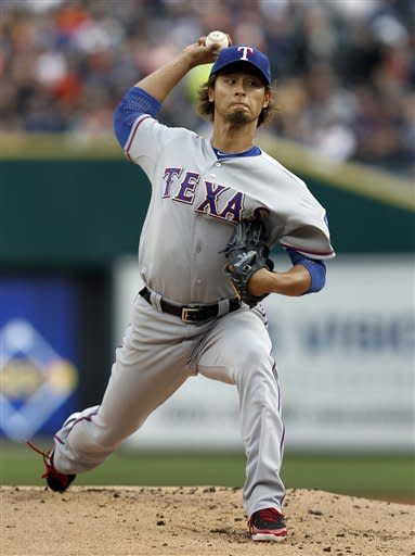 Texas Rangers pitcher Yu Darvish throws against the Detroit Tigers in the first inning of a baseball game in Detroit, Thursday, April 19, 2012. (AP Photo/Paul Sancya)
