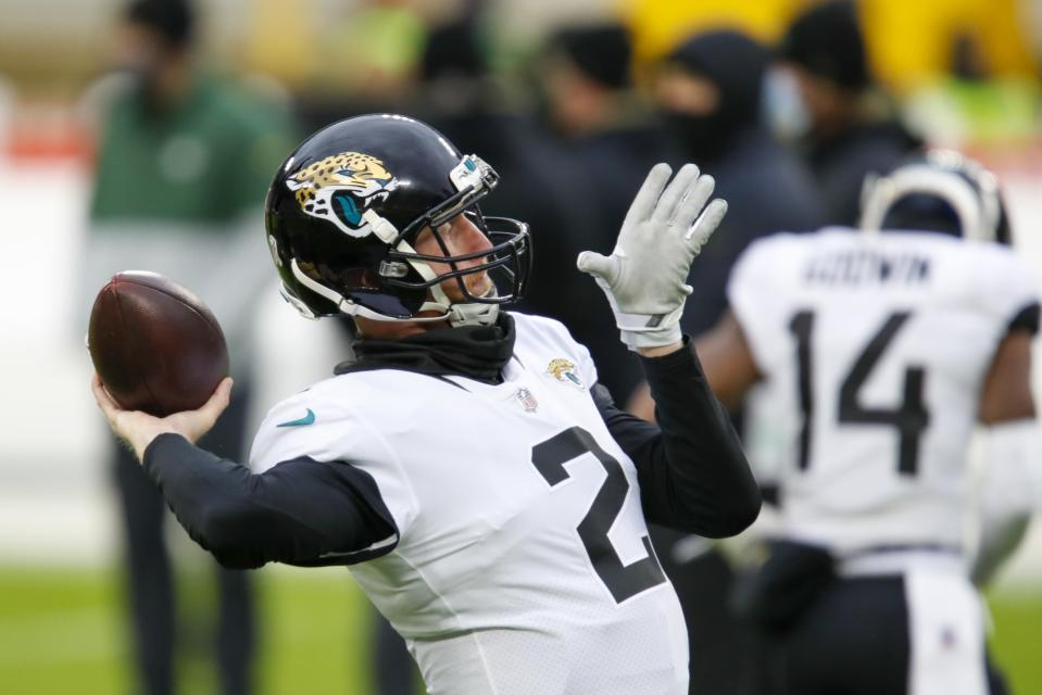 Jacksonville Jaguars' Mike Glennon warms up before an NFL football game against the Green Bay Packers Sunday, Nov. 15, 2020, in Green Bay, Wis. (AP Photo/Matt Ludtke)