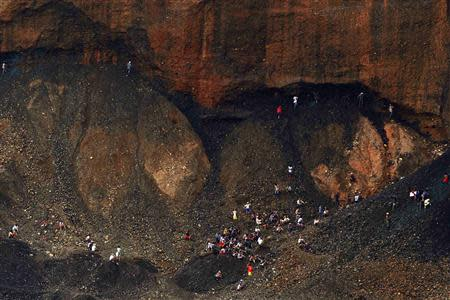 Hand-pickers search for jade through rubble dumped by mining companies at a jade mine in Hpakant township, Kachin State