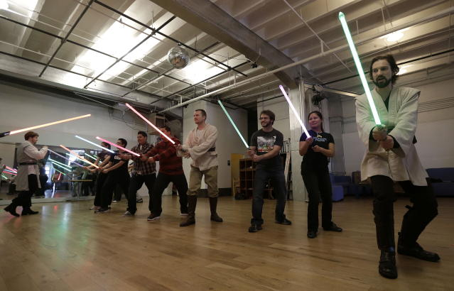 Golden Gate Knights instructor Alain Bloch, right, teaches during class in San Francisco, Sunday, Feb. 10, 2013. A group of San Francisco Star Wars fans who want to travel to a galaxy not that far away have created a combat choreography class for Jedis-in-training with their weapon of choice: the light saber. (AP Photo/Jeff Chiu)