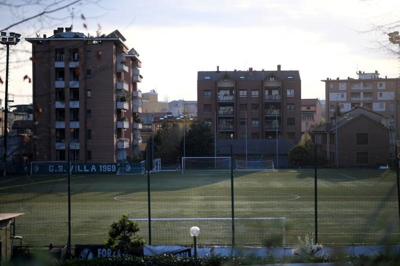 FILE PHOTO: A general view of an empty football field, as the spread of the coronavirus disease (COVID-19) continues, in Milan