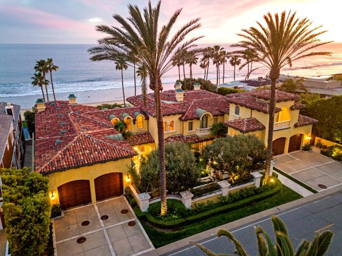 Listed for $42 million, the Mediterranean mansion wraps around a serene courtyard with statues, fountains and colorful gardens.