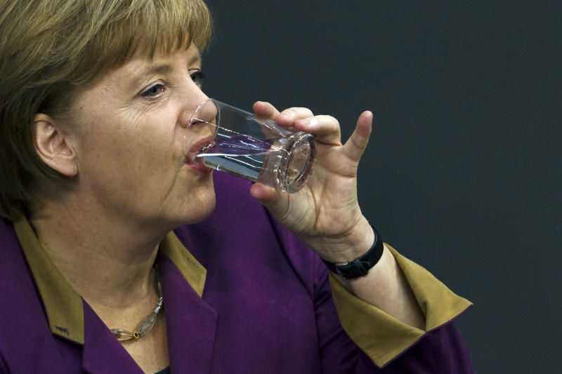 """German Chancellor Angela Merkel drinks water after her speech prior to the debate and the voting of the German Parliament Bundestag about a new Greek rescue package Berlin, Germany, Monday, Feb. 27, 2012. Merkel urged German lawmakers to support the new rescue package on, though she conceded that there is no """"100 percent guarantee"""" it will succeed. (AP Photo/Markus Schreiber)"""