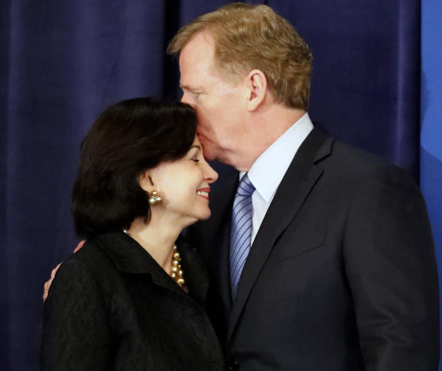 NFL commissioner Roger Goodell kisses New Orleans Saints owner Gayle Benson on the forehead before announcing New Orleans has been selected to host the 2024 Super Bowl during the NFL owner's spring meeting Wednesday, May 23, 2018, in Atlanta. (AP Photo/John Bazemore)