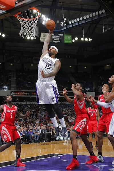 SACRAMENTO, CA - FEBRUARY 25: DeMarcus Cousins #15 of the Sacramento Kings dunks the ball against Terrance Jones #6 of the Houston Rockets at Sleep Train Arena on February 25, 2014 in Sacramento, California. (Photo by Rocky Widner/NBAE via Getty Images)