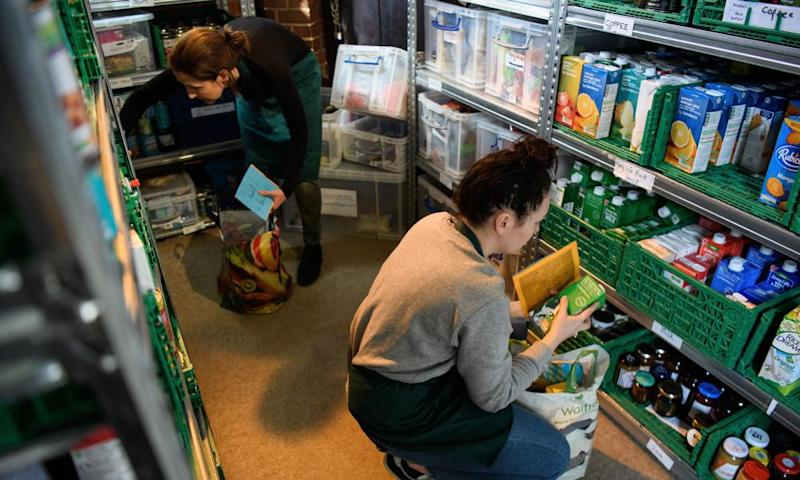 Volunteers at a foodbank in Wandsworth prepare food parcels