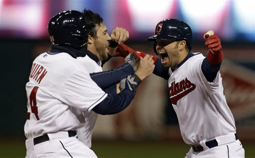 Cleveland Indians' Nick Swisher, right, celebrates with teammates Michael Bourn, left, and Jason Kipnis after hitting a game-winning RBI-single off Chicago White Sox pitcher Jesse Crain in the ninth inning of a baseball game on Friday, April 12, 2013, in Cleveland. Bourn scored on the play. Cleveland won 1-0. (AP Photo/Tony Dejak)