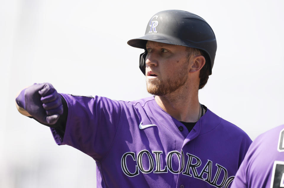 Colorado Rockies' Kyle Freeland gestures to the dugout after reaching first base with a two-run single off Los Angeles Dodgers starting pitcher Max Scherzer in the second inning of a baseball game Thursday, Sept. 23, 2021, in Denver. (AP Photo/David Zalubowski)