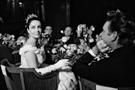 <p>No one could take their eyes off the actress at the 1963 Paris premiere of <em>Lawrence of Arabia</em>—including her <em>Cleopatra</em> costar Richard Burton, pictured here sitting next to her. Not long after this picture was taken, they got married in Montreal.</p>