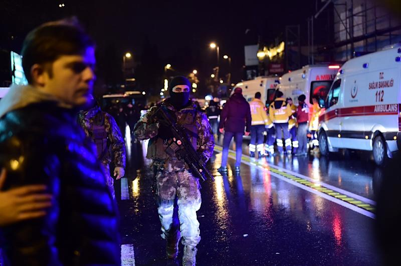 Turkish special force police officers and ambulances are seen at the site of an armed attack January 1, 2017 in Istanbul