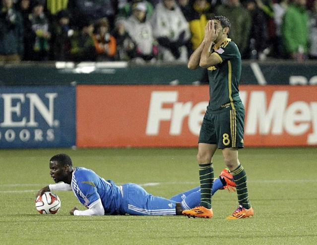 Portland Timbers midfielder Diego Valeri, right, reacts after fouling Philadelphia Union midfielder Maurice Edu during the first half of an MLS soccer game in Portland, Ore., Saturday, March 8, 2014. (AP Photo/Don Ryan)