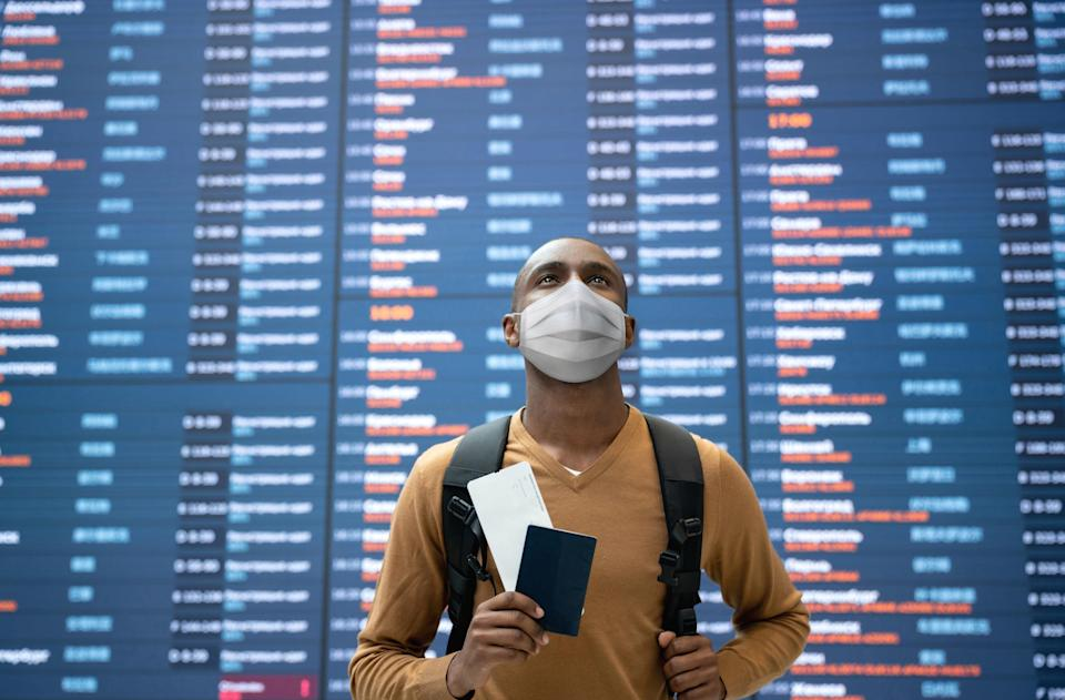 A traveler holding travel documents