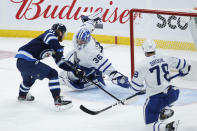 Winnipeg Jets' Kyle Connor (81) scores on Toronto Maple Leafs goaltender Jack Campbell (36) as TJ Brodie (78) defends during the second period of an NHL hockey game Friday, May 14, 2021, in Winnipeg, Manitoba. (John Woods/The Canadian Press via AP)