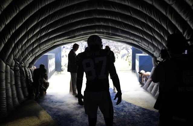Indianapolis Colts' Reggie Wayne (87) waits to run onto the field before an NFL football game against the Miami Dolphins Sunday, Sept. 15, 2013, in Indianapolis. (AP Photo/AJ Mast)