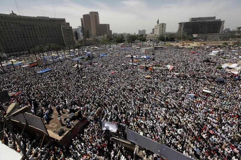 Egyptian protesters attend Friday prayers during a rally in Tahrir square, Cairo, Egypt, Friday, April 20, 2012. Tens of thousands of protesters packed Cairo's downtown Tahrir Square on Friday in the biggest demonstration in months against the ruling military, aimed at stepping up pressure on the generals to hand over power to civilians and bar ex-regime members from running in upcoming presidential elections.(AP Photo/Nasser Nasser)
