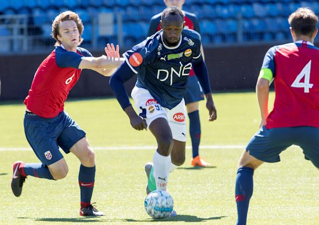 Jamaican sprint legend Usain Bolt and Norway's U19 player Fredrik Horn Myhre play in a friendly football match between Stromsgodset and Norway's U19 team at Marienlyst Stadium in Drammen, Norway, June 5, 2018. NTB Scanpix/Vidar Ruud via REUTERS ATTENTION EDITORS - THIS IMAGE WAS PROVIDED BY A THIRD PARTY. NORWAY OUT. NO COMMERCIAL OR EDITORIAL SALES IN NORWAY.