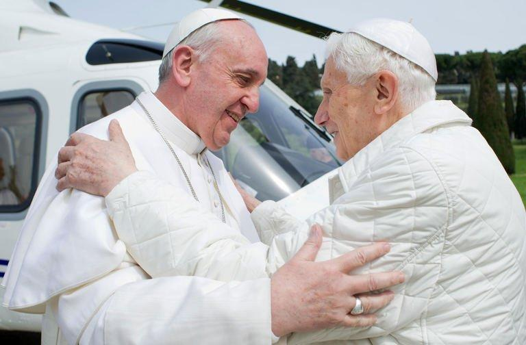 """Pope emeritus"" Benedict XVI (R) greets Pope Francis upon his arrival at the heliport in Castel Gandolfo, March 23, 2013"