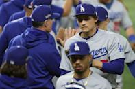 Corey Seager celebrates with Los Angeles teammates after hitting two home runs in their 7-3 series-extending victory over the Atlanta Braves in baseball's National League Championship Series