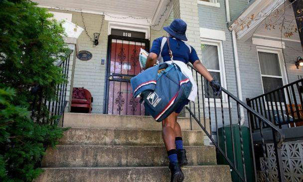 PHOTO: A United States Postal Service mail carrier delivers mail in Washington, Aug. 18, 2020. (Michael Reynolds/EPA via Shutterstock, FILE)