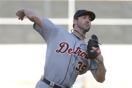 October 10, 2013; Oakland, CA, USA; Detroit Tigers starting pitcher Justin Verlander (35) delivers a pitch against the Oakland Athletics during the first inning in game five of the American League divisional series playoff baseball game at O.co Coliseum. Kyle Terada-USA TODAY Sports