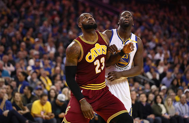 LeBron James' Cavaliers and Draymond Green's Warriors appear to be on a collision course. (Ezra Shaw/Getty Images)
