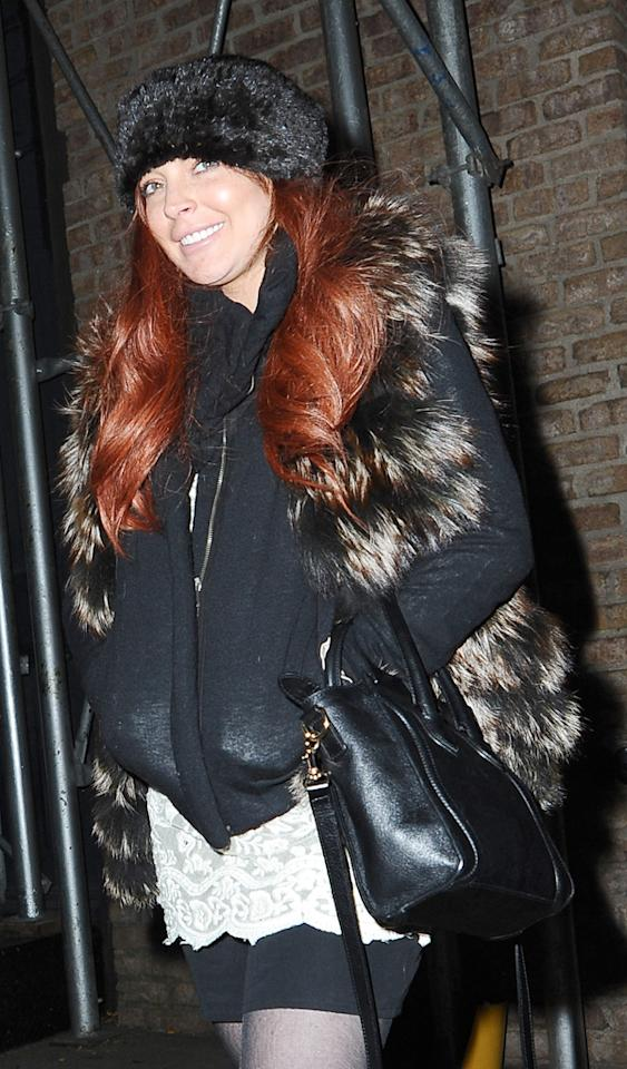 Lindsay Lohan coming out of the hotel and she is not  driving in NYC.