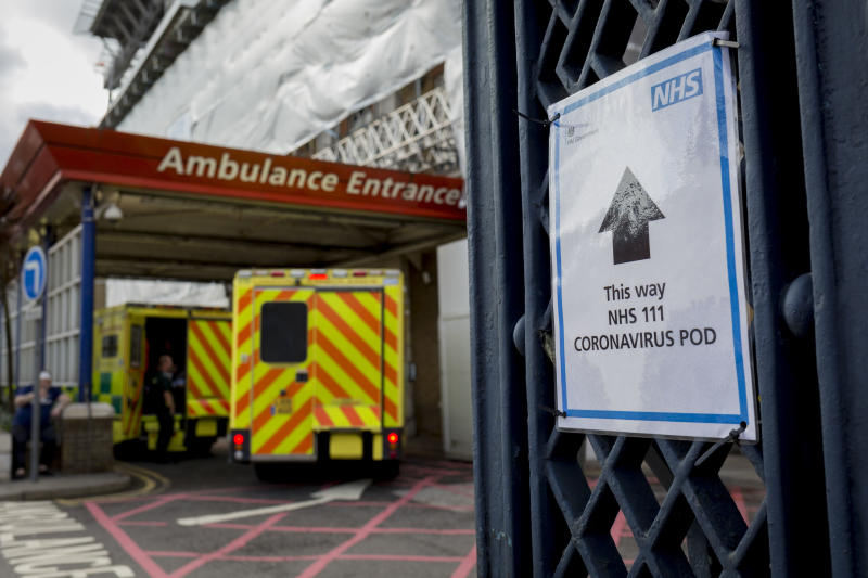 An NHS sign points towards a Coronavirus testing pod, as an ambulance arrives at the A&E Department of Kings College Hospital in Camberwell, south London, on 11th March 2020, in London, England. (Photo by Richard Baker / In Pictures via Getty Images)