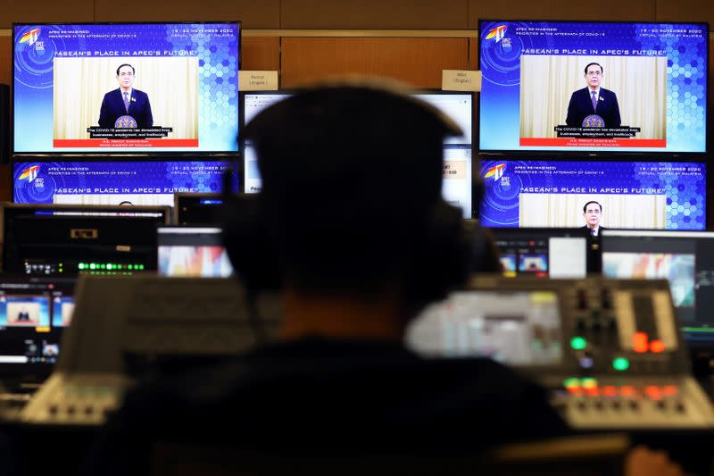 Screens show Thailand's Prime Minister Prayuth Chan-ocha speaking during the virtual APEC CEO Dialogues 2020, at its command center in Kuala Lumpur