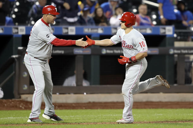 Philadelphia Phillies' J.T. Realmuto (10) celebrates with third base coach Dusty Wathan, left, after hitting a tying two-run home run with during the ninth inning of a baseball game Friday, Sept. 6, 2019, in New York. (AP Photo/Mary Altaffer)