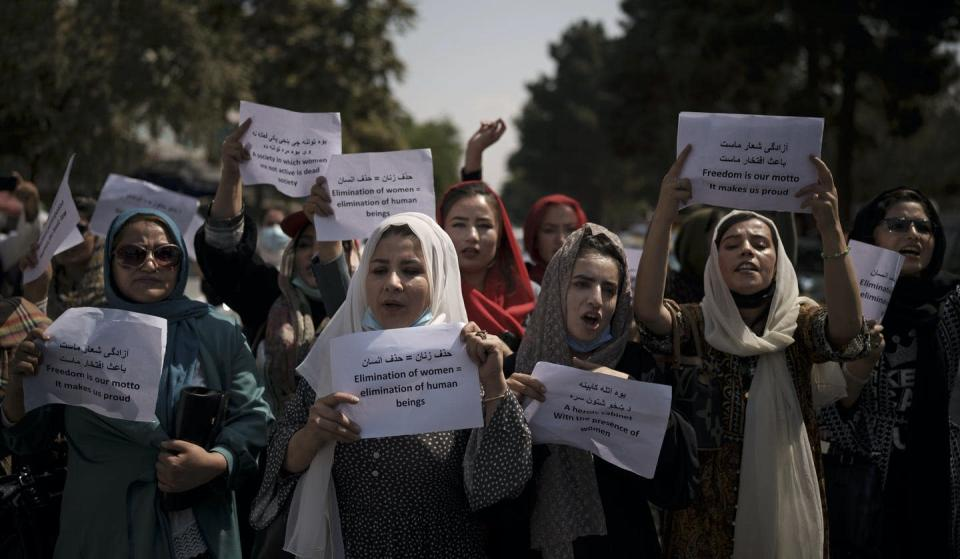 """<span class=""""caption"""">Afghan women march to demand their rights under Taliban rule during a demonstration near the former Women's Affairs Ministry building in Kabul.</span> <span class=""""attribution""""><span class=""""source"""">(AP Photo)</span></span>"""