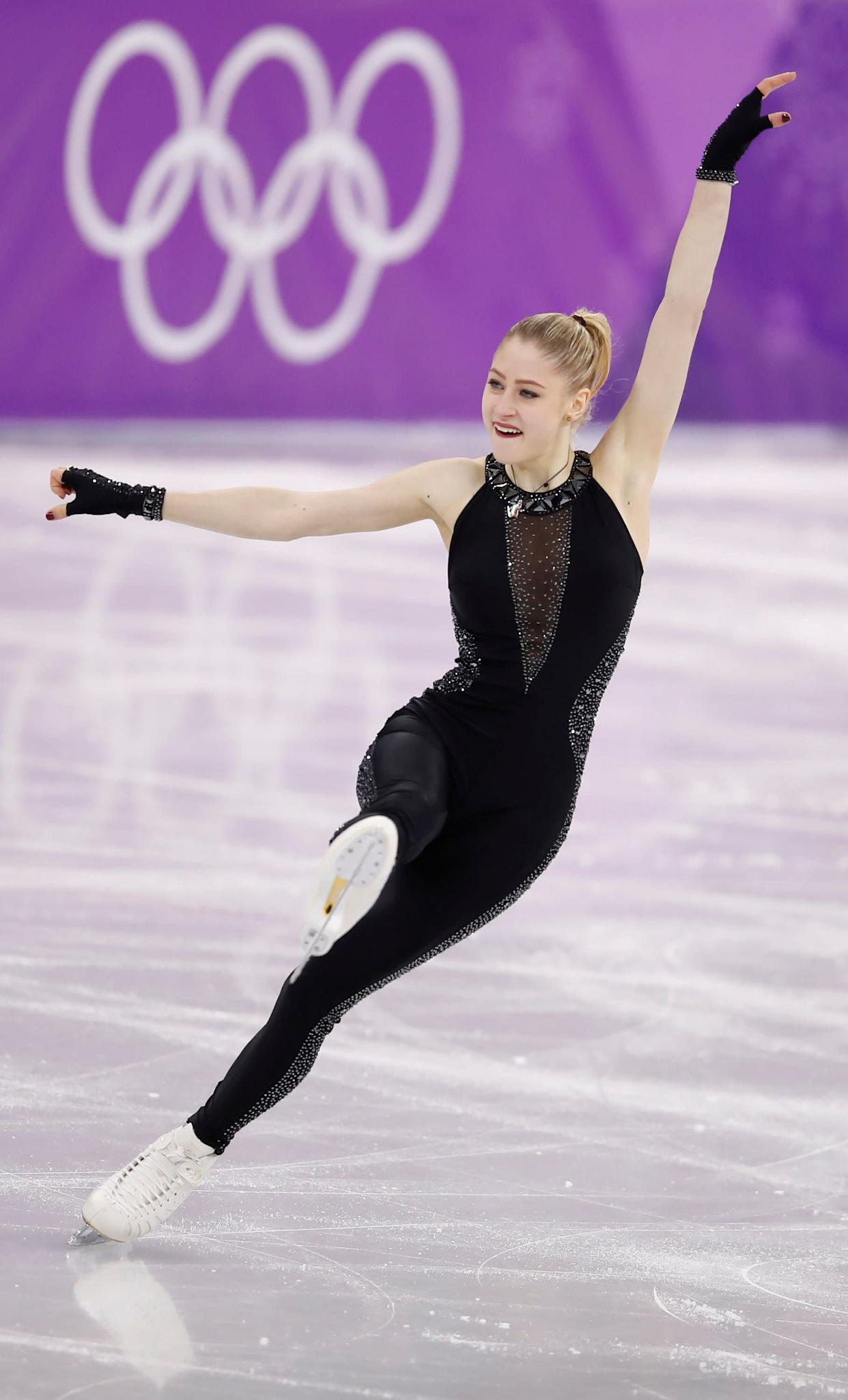 Nikitina, of Latvia, was another woman who chose a unitard, and hers was definitely the most subtle. We think it worked in her favor -- the rhinestoned sides add sparkle, and the dark mesh V-neck panel keeps it from looking too simple.