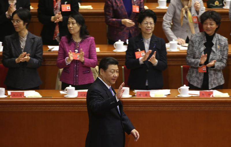 China's President Xi Jinping waves to delegates in Beijing