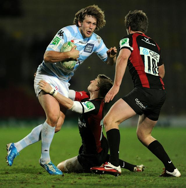 Racing's centre Francois Steyn (L) fights off a tackle from Saracen's centre David Strettle (bottom) in front of Saracen's Owen Farrell (R) during the Heineken Cup rugby union match between Saracens and Racing Metro 92 at Vicarage Road in Watford on December 11, 2010. Racing Metro 92 won the game 24-21. AFP PHOTO / Adrian Dennis (Photo credit should read ADRIAN DENNIS/AFP/Getty Images)