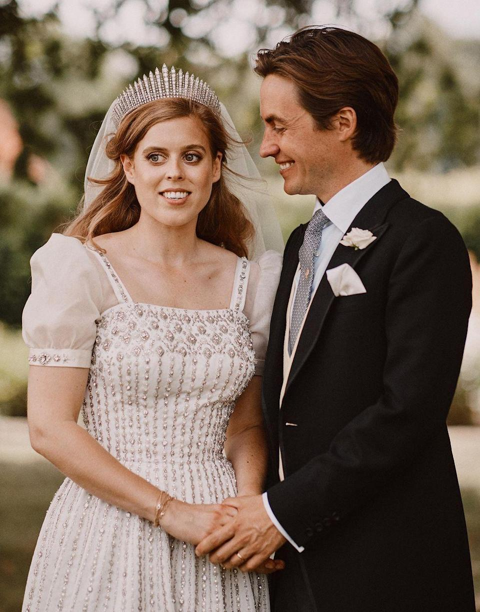 """<p>Queen Elizabeth II and Princess Anne both wore The Queen Mary Fringe Tiara on their wedding days, and Her Majesty loaned the piece to her granddaughter, Princess Beatrice of York, for her intimate wedding to Edoardo Mapelli Mozzi. The tiara, which many believe was selected due to both it's sentimental significance and its all-diamond design, which complemented the bride's Norman Hartnell gown also on loan from the Queen, marks the first time a modern royal bride has donned a tiara worn by another ancestral royal (let alone two) for her wedding day. According to <em><a href=""""https://www.townandcountrymag.com/style/jewelry-and-watches/a33369061/queen-elizabeth-princess-beatrice-wedding-tiara-meaning/"""" rel=""""nofollow noopener"""" target=""""_blank"""" data-ylk=""""slk:Town & Country"""" class=""""link rapid-noclick-resp"""">Town & Country</a>,</em> given Beatrice and Edo's postponement of a larger-scale celebration due to the pandemic, the Queen likely chose this piece with far greater symbolism in mind: to signify the royal family's history, as well as solidarity, strength, and endurance.</p>"""