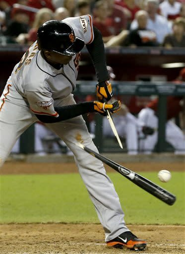 San Francisco Giants' Joaquin Arias breaks his bat on a checked swing against the Arizona Diamondbacks during the seventh inning in a baseball game on Sunday, June 9, 2013, in Phoenix. (AP Photo/Ross D. Franklin)