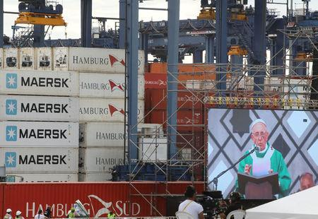 Pope Francis is seen on a screen as he leads a mass at the Contecar harbour in Cartagena, Colombia September 10, 2017. REUTERS/Nacho Doce