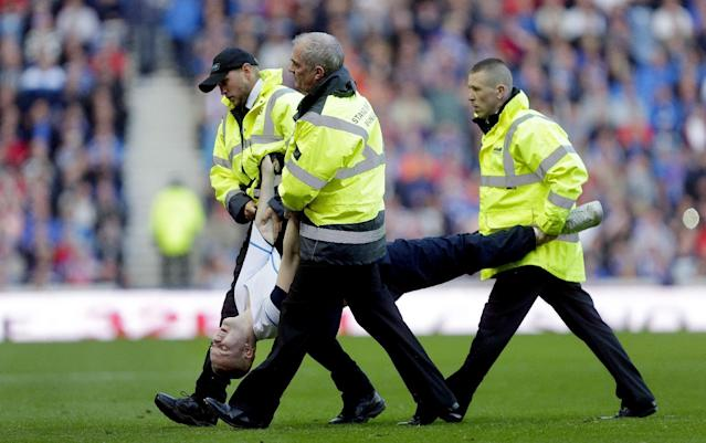 Football - Rangers v St Mirren - Ladbrokes Scottish Championship - Ibrox Stadium - 7/8/15 Match Stewards escort a fan off the pitch Action Images via Reuters / Graham Stuart Livepic EDITORIAL USE ONLY.