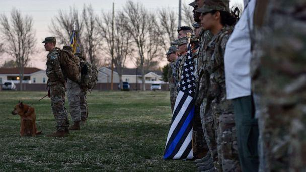 PHOTO: Participants of the 2019 377th Security Forces Squadron Suicide Awareness Ruck March stand in formation at Kirtland Air Force Base, N.M., March 29, 2019. (Austin Prisbrey/U.S. Air Force)