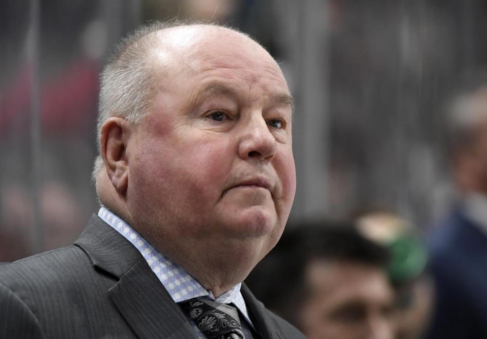 Minnesota Wild head coach Bruce Boudreau watches his team play against the Colorado Avalanche during the first period of an NHL hockey game Sunday, Feb. 9, 2020, in St. Paul, Minn. (AP Photo/Hannah Foslien)