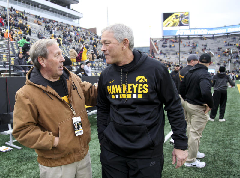 IOWA CITY, IOWA- OCTOBER 28: Head coach Kirk Ferentz of the Iowa Hawkeyes visits with University President Bruce Harreld before the match-up against the Minnesota Golden Gophers on October 28, 2017 at Kinnick Stadium in Iowa City, Iowa. (Photo by Matthew Holst/Getty Images)