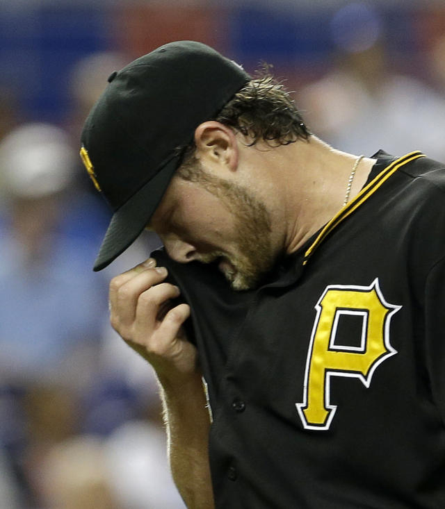 Pittsburgh Pirates starting pitcher Gerrit Cole wipes his face as he heads to the dugout after the Miami Marlins scored two runs during the fourth inning of a baseball game in Miami, Sunday, July 28, 2013. (AP Photo/Alan Diaz)